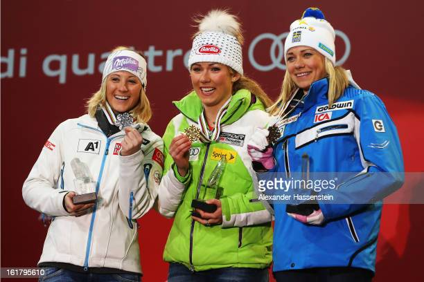 Race winner Mikaela Shiffrin of the United States of America celebrates with second placed Michaela Kirchgasser of Austria and third placed Frida...