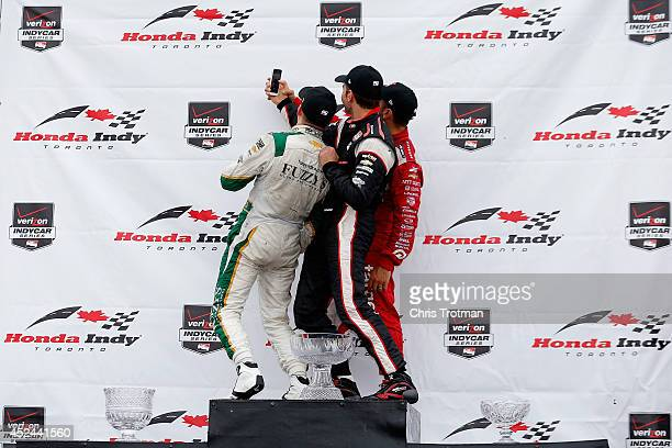 Race winner Mike Conway of England driver of the Ed Carpenter Racing Dallara Chevrolet takes a selfie with third place finisher Will Power of...