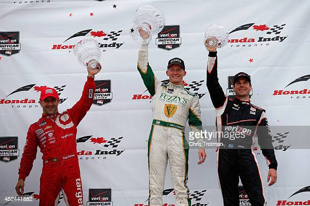 Race winner Mike Conway of England driver of the Ed Carpenter Racing Dallara Chevrolet, third place finisher Will Power of Australia driver of the...