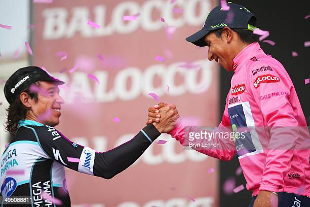 Race winner Nairo Quintana of Colombia and the Movistar Team shakes hands with compatriot Rigoberto Uran of team Omega PharmaQuickStep following the...