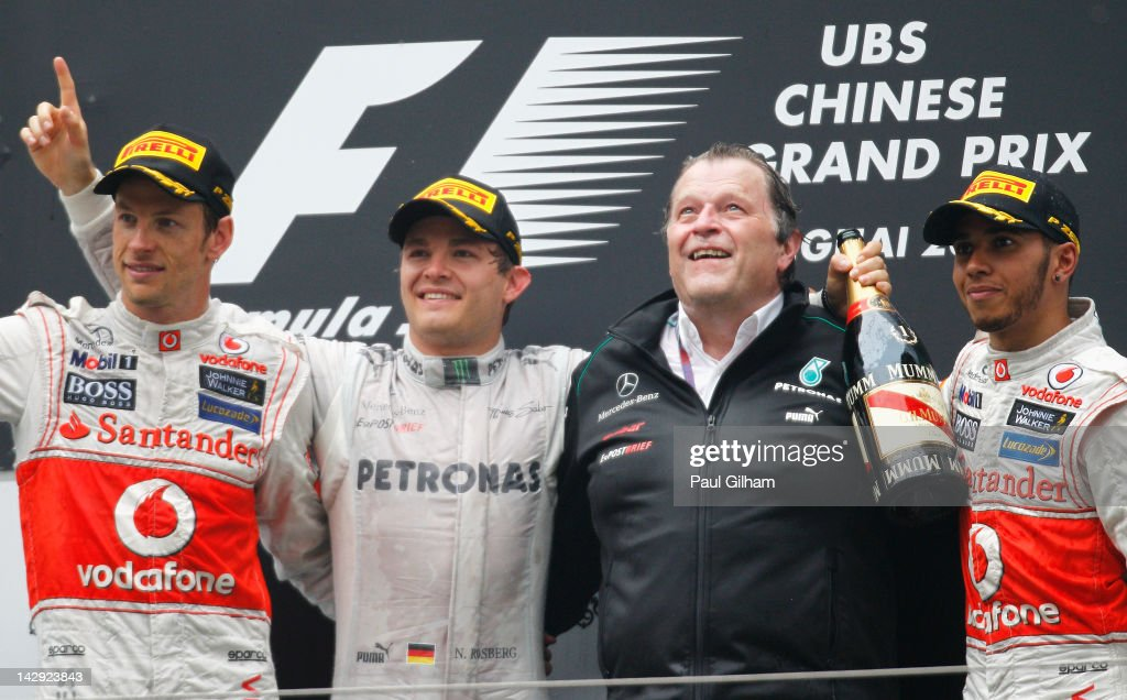 Race winner Nico Rosberg (2nd left) of Germany and Mercedes GP celebrates with second placed Jenson Button (left) of Great Britain and McLaren, third placed Lewis Hamilton (right) of Great Britain and McLaren and Norbert Haug (2nd right) of Mercedes Motorsport on the podium following the Chinese Formula One Grand Prix at the Shanghai International Circuit on April 15, 2012 in Shanghai, China.