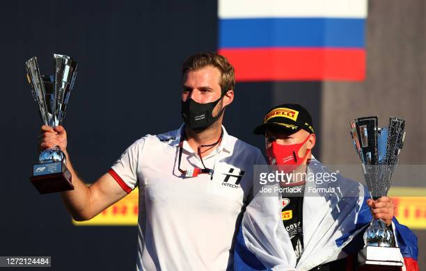Race winner Nikita Mazepin of Russia and Hitech Grand Prix and Hitech Grand Prix race engineer Jan Sumann celebrate on the podium during the Formula...