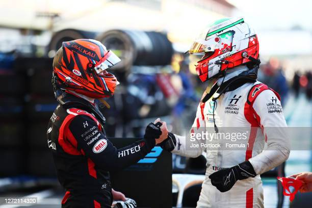 Race winner Nikita Mazepin of Russia and Hitech Grand Prix and second placed Luca Ghiotto of Italy and Hitech Grand Prix celebrate in parc ferme...