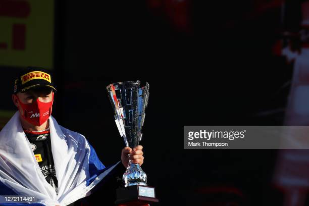 Race winner Nikita Mazepin of Russia and Hitech Grand Prix celebrates on the podium during the Formula 2 Championship Feature Race at Mugello Circuit...
