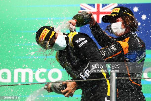 Race winner Oscar Piastri of Australia and Prema Racing and second placed Alex Peroni of Australia and Campos Racing celebrate on the podium during...
