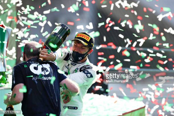Race winner Pierre Gasly of France and Scuderia AlphaTauri and Graham Watson, Team Manager of Scuderia AlphaTauri celebrate on the podium during the...