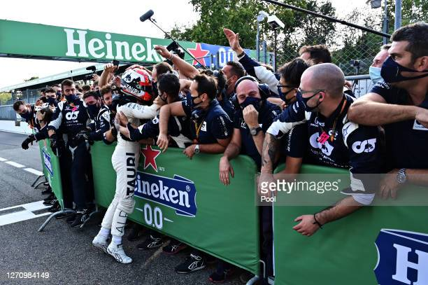 Race winner Pierre Gasly of France and Scuderia AlphaTauri celebrates with teammates in parc ferme during the F1 Grand Prix of Italy at Autodromo di...