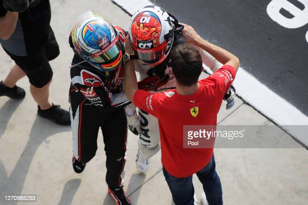 Race winner Pierre Gasly of France and Scuderia AlphaTauri is congratulated by Romain Grosjean of France and Haas F1 and Charles Leclerc of Monaco...
