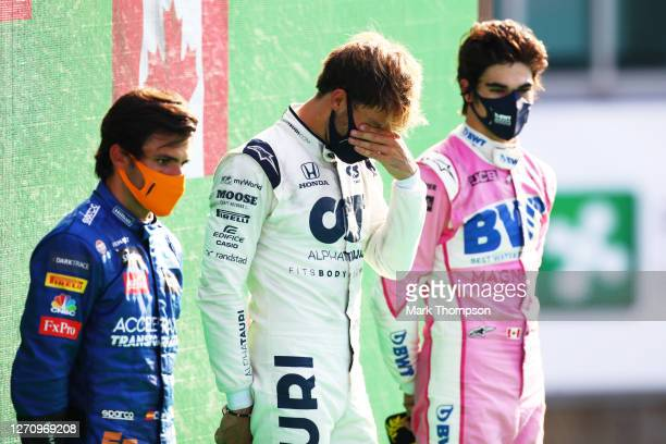 Race winner Pierre Gasly of France and Scuderia AlphaTauri, second placed Carlos Sainz of Spain and McLaren F1 and third placed Lance Stroll of...
