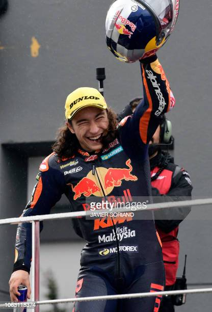 Race winner Red Bull KTM Ajo's Turkish rider Can Oncu celebrates on the podium after the Moto3 race of the Valencia Grand Prix at the Ricardo Tormo...