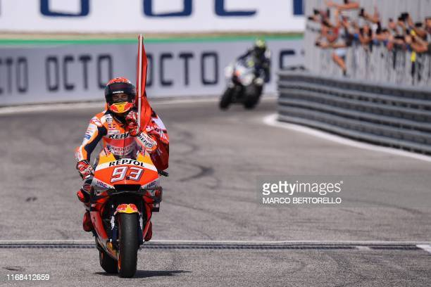 Race winner Repsol Honda Team Spanish rider, Marc Marquez performs a lap of honour after the San Marino MotoGP Grand Prix race at the Misano World...