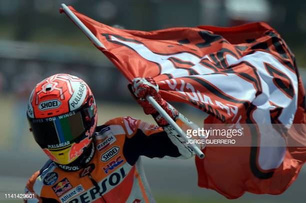 Race winner Repsol Honda Team's Spanish rider Marc Marquez celebrates after the MotoGP race of the Spanish Grand Prix at the Jerez Angel Nieto...