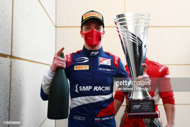 Race winner Robert Shwartzman of Russia and Prema Racing celebrates on the podium during the Round 11:Sakhir Sprint Race of the Formula 2...