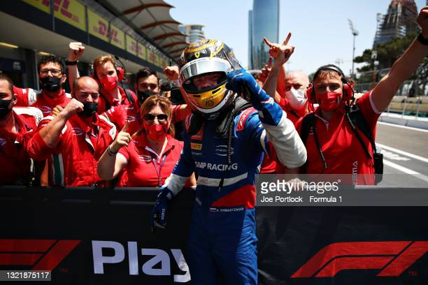 Race winner Robert Shwartzman of Russia and Prema Racing celebrates with team members in parc ferme after winning the sprint race 1 of Round 3:Baku...