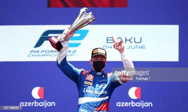 Race winner Robert Shwartzman of Russia and Prema Racing celebrates on the podium after winning the sprint race 1 of Round 3:Baku of the Formula 2...