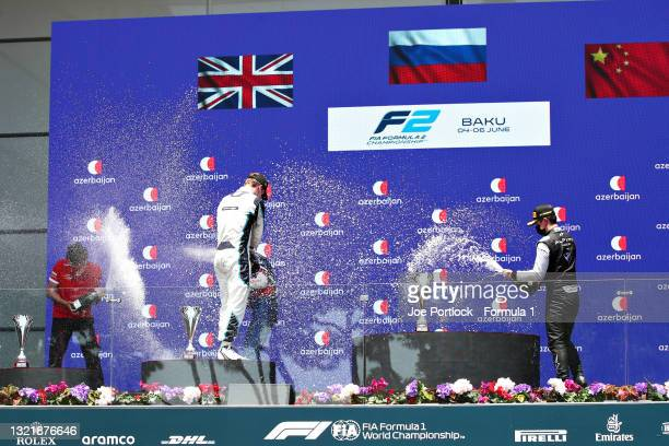 Race winner Robert Shwartzman of Russia and Prema Racing, second placed Dan Ticktum of Great Britain and Carlin and third placed Guanyu Zhou of China...
