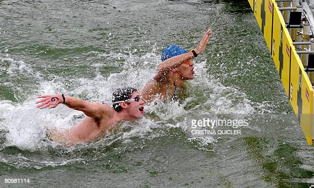 Race winner Russian Vladimir Dyatchin competes againts British David Davies who won second during the men's 10 km event at the World Open Water...