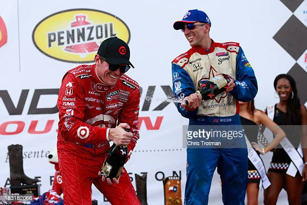Race winner Scott Dixon of New Zealand driver of the Target Chip Ganassi Racing Honda Dallara and third place finisher Justin Wilson driver of the...