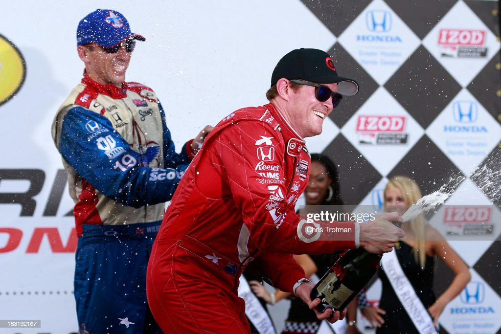 Race winner (R) Scott Dixon, of New Zealand, driver of the #9 Target Chip Ganassi Racing Honda Dallara and third place finisher (L) Justin Wilson driver of the #19 Dale Coyne Racing Honda Dallara celebrate with champagne in victory lane following the IZOD IndyCar Series Shell and Pennzoil Grand Prix Of Houston Race 1 at Reliant Park on October 5, 2013 in Houston, Texas.