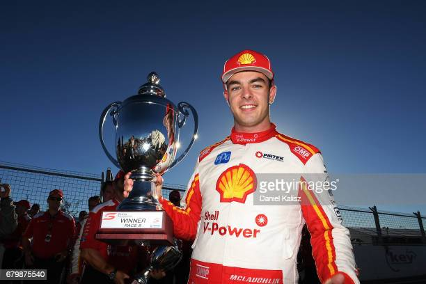 Race winner Scott McLaughlin driver of the Shell VPower Racing Team Ford Falcon FGX poses for a photo with his trophy after race 8 for the Perth...