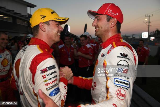 Race winner Scott McLaughlin driver of the Shell VPower Racing Team Ford Falcon FGX is congratulated by his team mate Fabian Coulthard driver of the...