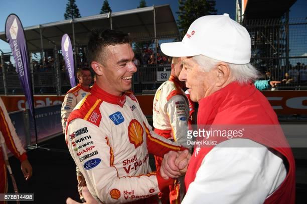 Race winner Scott McLaughlin driver of the Shell VPower Racing Team Ford Falcon FGX is gongratulated by Roger Penske team owner of DJR Team Penske...