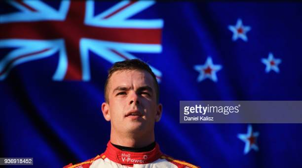 Race winner Scott McLaughlin driver of the Shell V-Power Racing Team Ford Falcon FGX celebrates on the podium during race 1 for the Supercars...