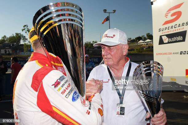 Race winner Scott McLaughlin driver of the Shell VPower Racing Team Ford Falcon FGX is congratulated by Dick Johnson team owner of DJR Team Penske...