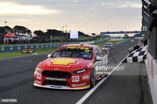 Race winner Scott McLaughlin drives the Shell VPower Racing Team Ford Falcon FGX takes the chequered flag during the Supercars Phillip Island 500 at...
