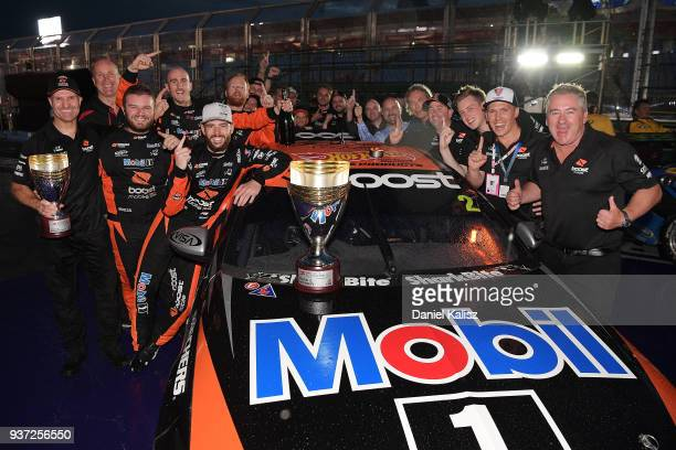 Race winner Scott Pye driver of the Mobil 1 Boost Mobile Racing Holden Commodore ZB celebrates with his team after race 3 for the Supercars...
