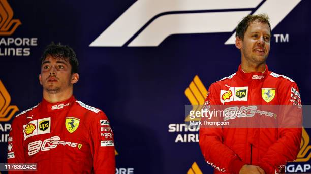 Race winner Sebastian Vettel of Germany and Ferrari and second placed Charles Leclerc of Monaco and Ferrari celebrate on the podium during the F1...