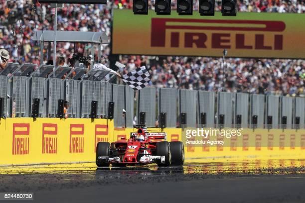 Race winner Sebastian Vettel of Germany and Ferrari celebrates during the Formula One Grand Prix of Hungary at Hungaroring on July 30 2017 in...