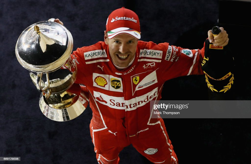 Race winner Sebastian Vettel of Germany and Ferrari celebrates his win on the podium during the Bahrain Formula One Grand Prix at Bahrain International Circuit on April 16, 2017 in Bahrain, Bahrain.