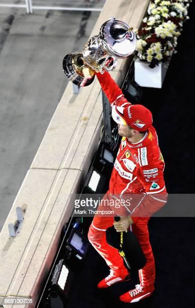 Race winner Sebastian Vettel of Germany and Ferrari celebrates his win on the podium during the Bahrain Formula One Grand Prix at Bahrain...