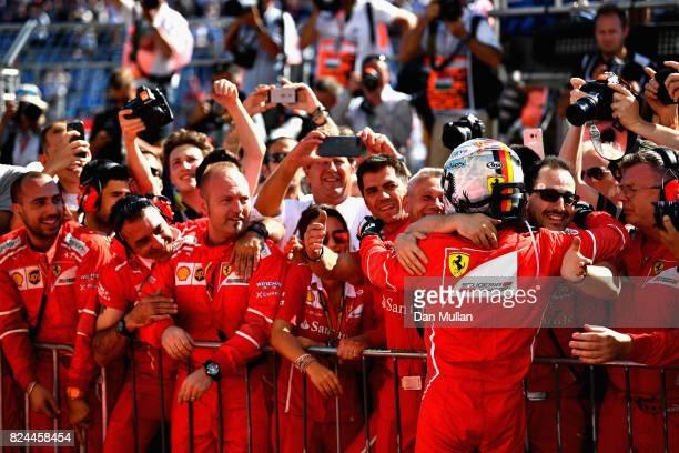 Race winner Sebastian Vettel of Germany and Ferrari celebrates his win in parc ferme during the Formula One Grand Prix of Hungary at Hungaroring on...