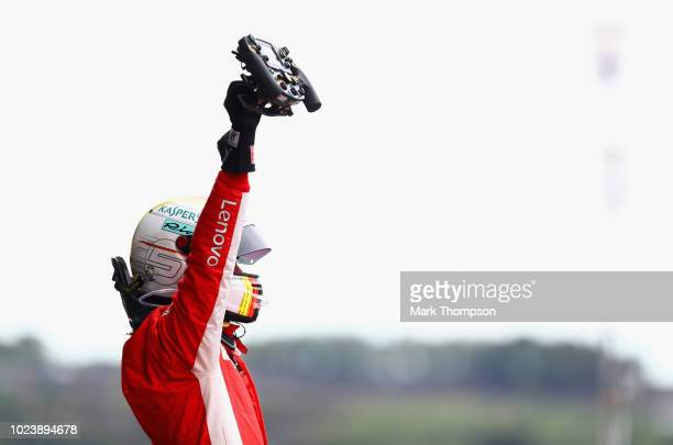 Race winner Sebastian Vettel of Germany and Ferrari celebrates in parc ferme during the Formula One Grand Prix of Belgium at Circuit de...