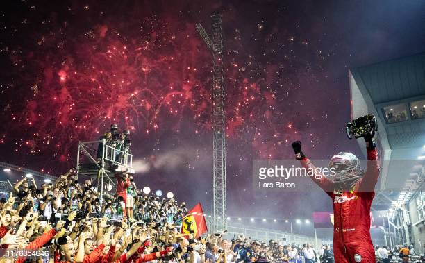 Race winner Sebastian Vettel of Germany and Ferrari celebrates in parc ferme during the F1 Grand Prix of Singapore at Marina Bay Street Circuit on...