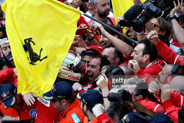 Race winner Sebastian Vettel of Germany and Ferrari celebrates in parc ferme during the Monaco Formula One Grand Prix at Circuit de Monaco on May 28...