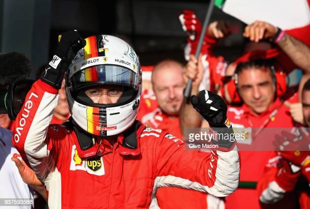 Race winner Sebastian Vettel of Germany and Ferrari celebrates in parc ferme during the Australian Formula One Grand Prix at Albert Park on March 25...