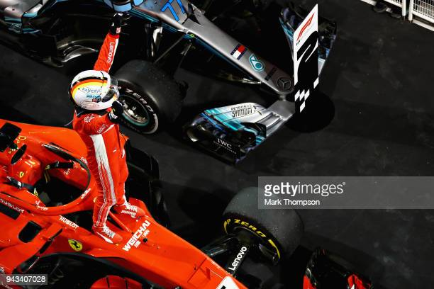 Race winner Sebastian Vettel of Germany and Ferrari celebrates in parc ferme during the Bahrain Formula One Grand Prix at Bahrain International...