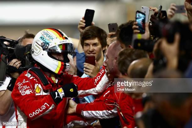 Race winner Sebastian Vettel of Germany and Ferrari celebrates in parc ferme during the Bahrain Formula One Grand Prix at Bahrain International...