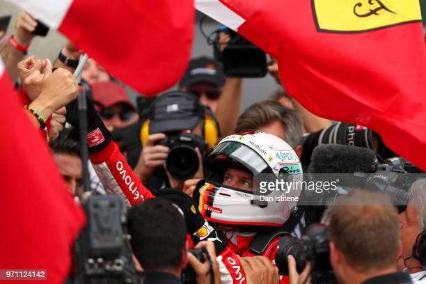 Race winner Sebastian Vettel of Germany and Ferrari celebrates in parc ferme during the Canadian Formula One Grand Prix at Circuit Gilles Villeneuve...