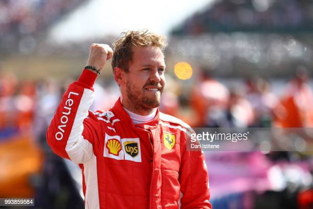 Race winner Sebastian Vettel of Germany and Ferrari celebrates in parc ferme during the Formula One Grand Prix of Great Britain at Silverstone on...