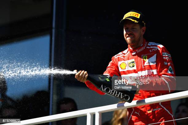 Race winner Sebastian Vettel of Germany and Ferrari celebrates on the podium during the Formula One Grand Prix of Brazil at Autodromo Jose Carlos...