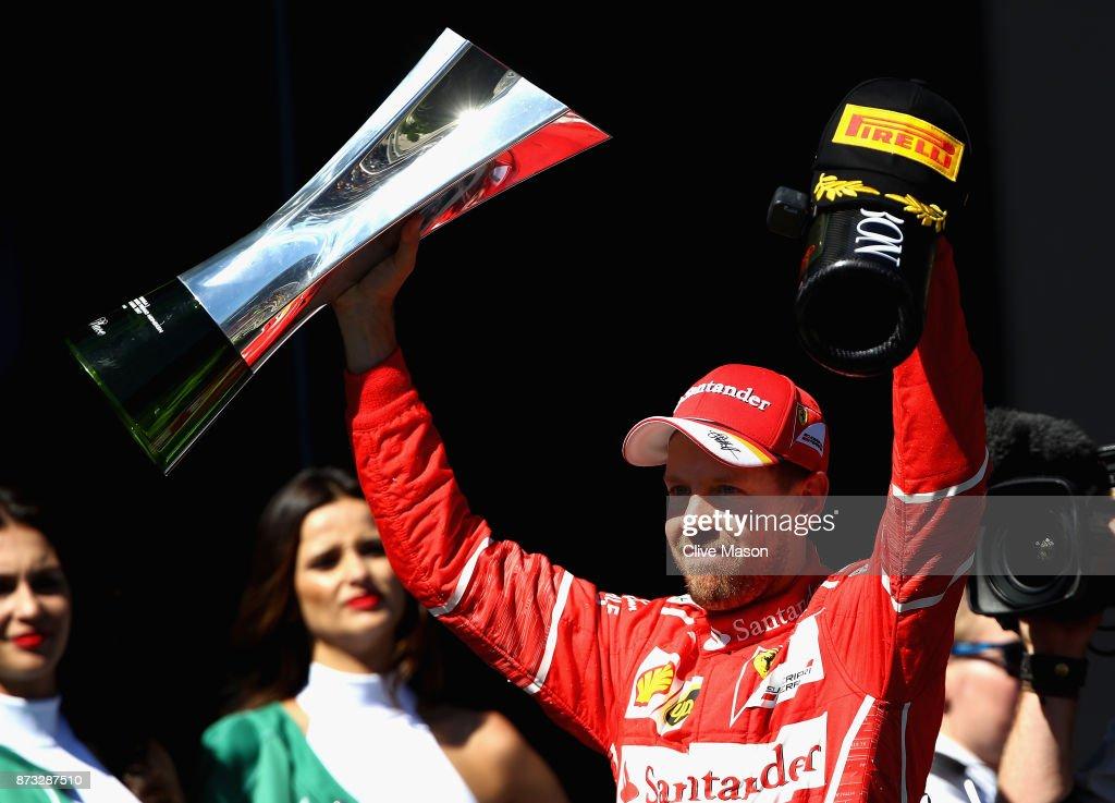 Race winner Sebastian Vettel of Germany and Ferrari celebrates on the podium during the Formula One Grand Prix of Brazil at Autodromo Jose Carlos Pace on November 12, 2017 in Sao Paulo, Brazil.