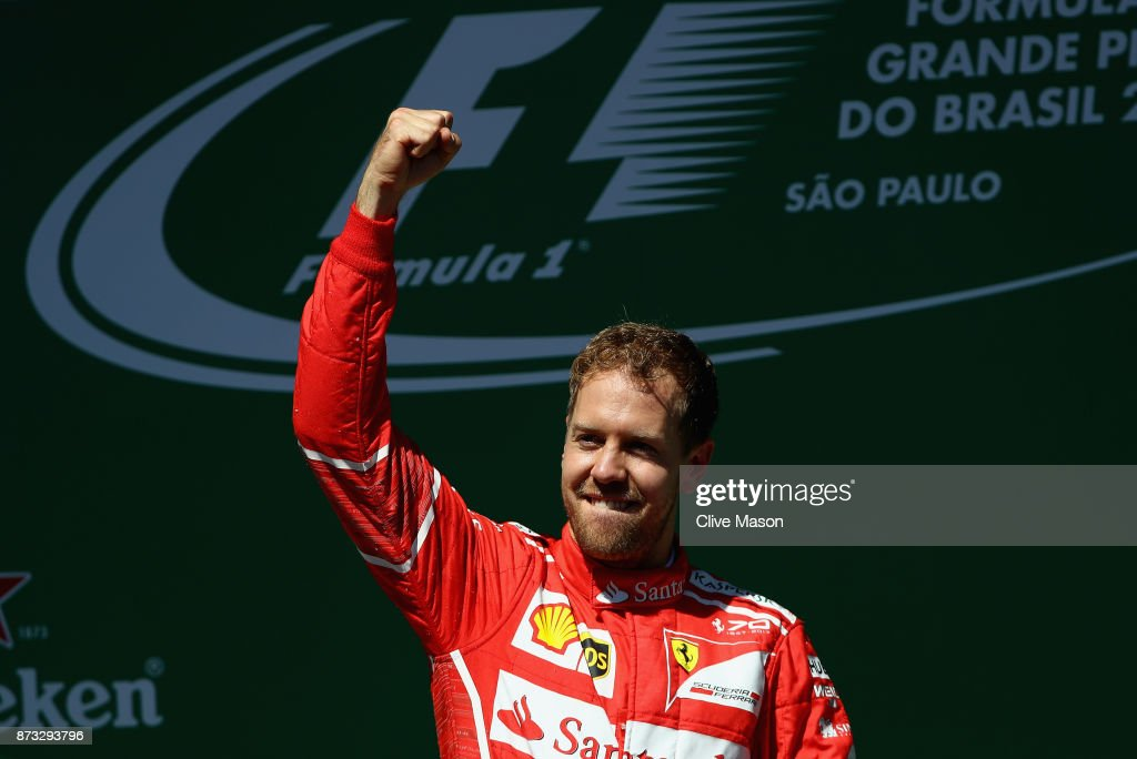 Race winner Sebastian Vettel of Germany and Ferrari celebrates on the podium during the Formula One Grand Prix of Brazil at Autodromo Jose Carlos Pace on November 12, 2017 in Sao Paulo, Brazil.