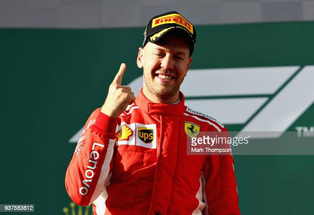 Race winner Sebastian Vettel of Germany and Ferrari celebrates on the podium during the Australian Formula One Grand Prix at Albert Park on March 25...