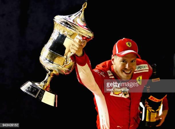 Race winner Sebastian Vettel of Germany and Ferrari celebrates on the podium during the Bahrain Formula One Grand Prix at Bahrain International...