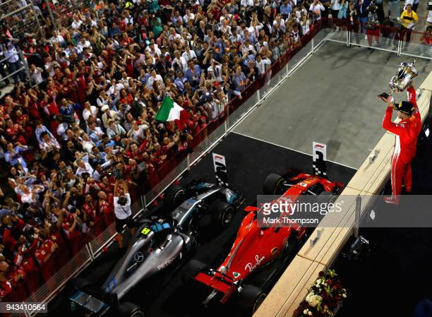 Race winner Sebastian Vettel of Germany and Ferrari celebrates on the podium during the Bahrain Formula One Grand Prix at Bahrain International...