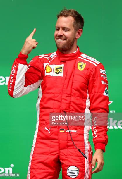 Race winner Sebastian Vettel of Germany and Ferrari celebrates on the podium with his trophy during the Canadian Formula One Grand Prix at Circuit...